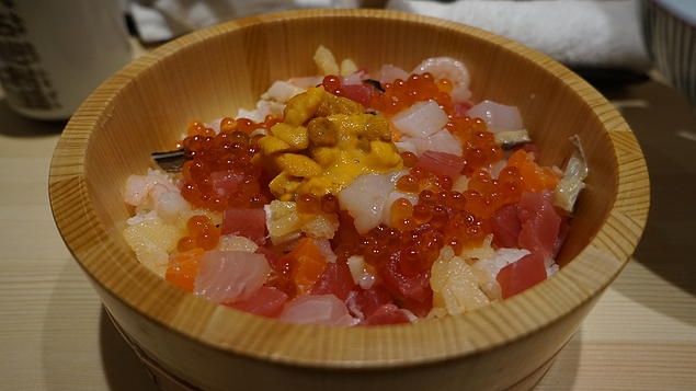 Sashimi Bowl at Tsukiji Fish Market served with the infamous sea urchin. Fresh and good!