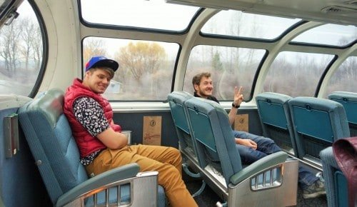 Travelers enjoying the lovely view at the VIA Rail Carriage