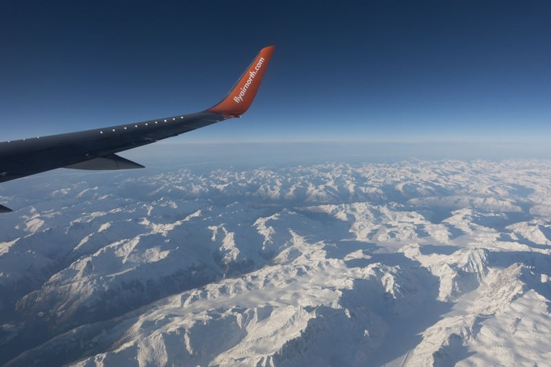Flying Air North over the snowy mountains