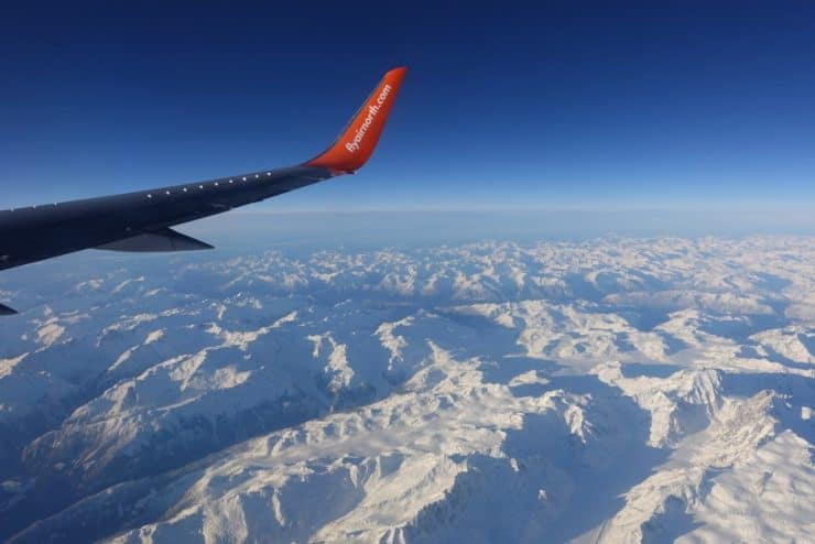 View of snowy mountains from my window seat on board Air North.