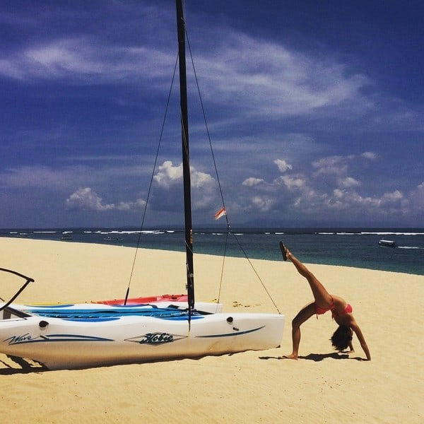 Couldnt resist doing a yoga pose next to this pretty boat by the sand