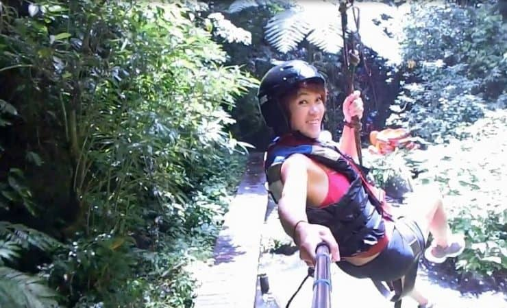 Bali Outdoor Adventure - Flying across the sky with the view of the river rapids and forests below