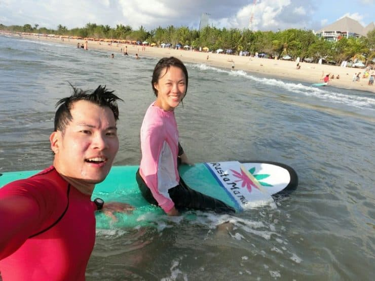 Surfing in progress. Behind those smiles, is a nose choked with sea water, aching shoulders and yet a persistent enthusiasm to keep jumping back into those ripcurls.
