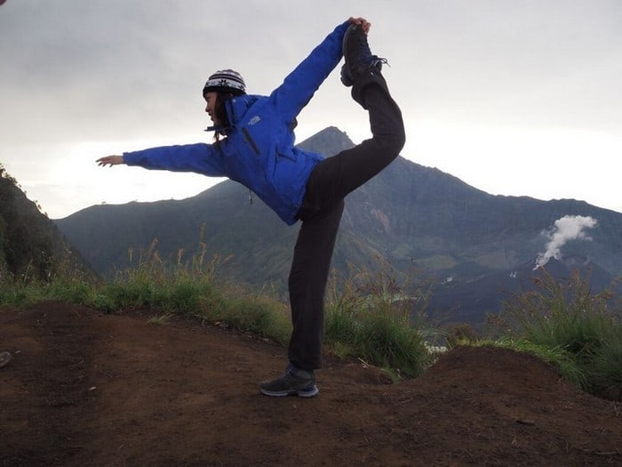 attempting a yoga dancer pose on mount rinjani