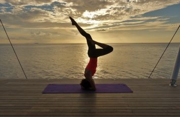 Headstand at morning sunrise yoga at AWAY Spa W Maldives