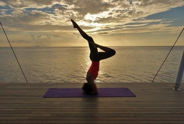 Headstand at morning sunrise yoga at AWAY Spa W Maldives