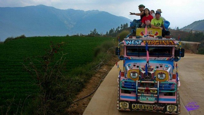 going crazy on top the jeepney on the way down the rolling hills on Philippines