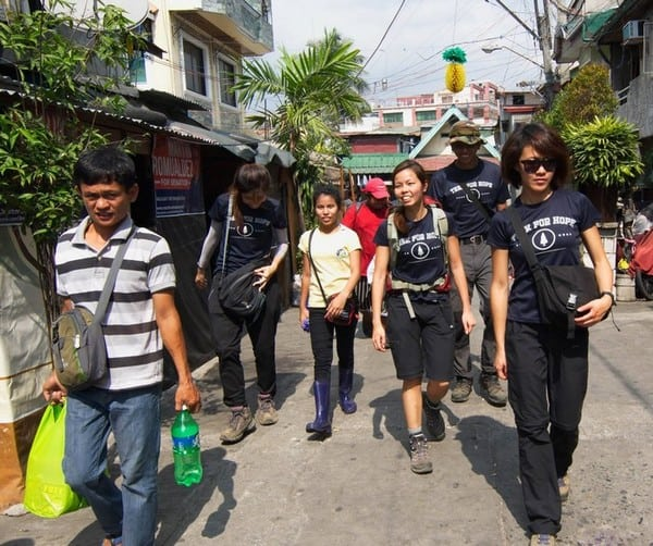 Walking through the housing area of these people in manila bring food rations to the residents | Slums in Manila