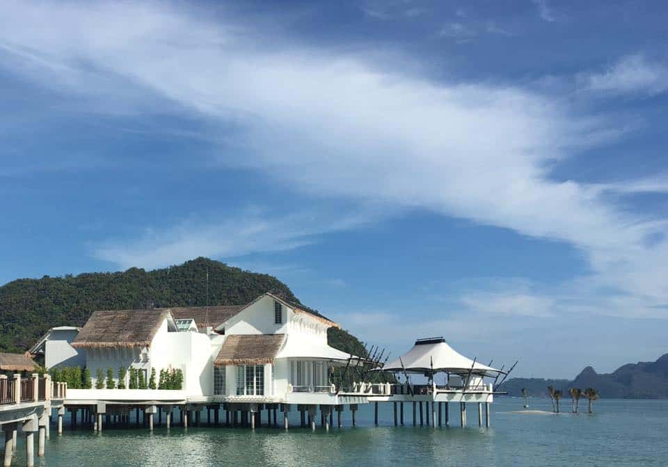 View of Kayuputi Restaurant at the St Regis Langkawi Malaysia Resort. Lovely over-water bungalow with a whitewash exterior and even more stunning interior.