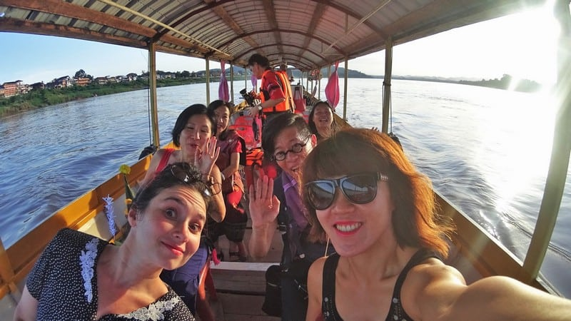 Wefie shot of all of us all comfy in the long tail boat along the mekong river