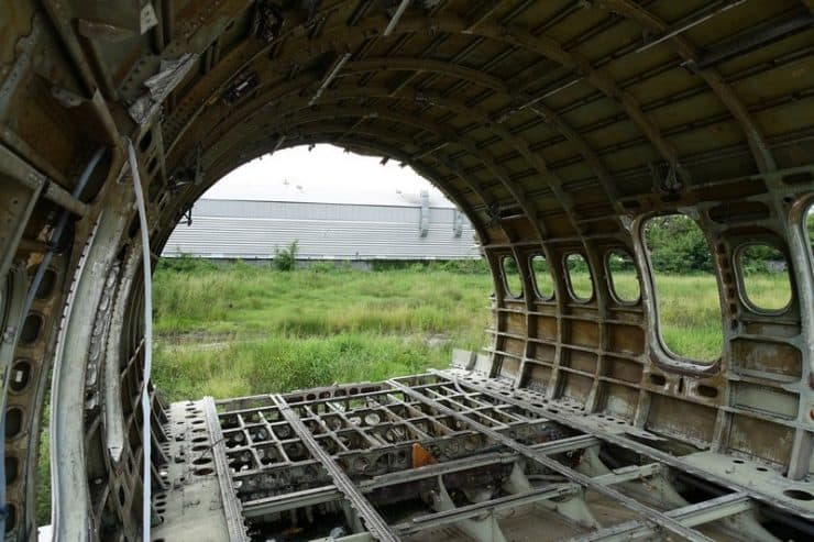 Perspective view from inside the one of the planes, with the grass field outside
