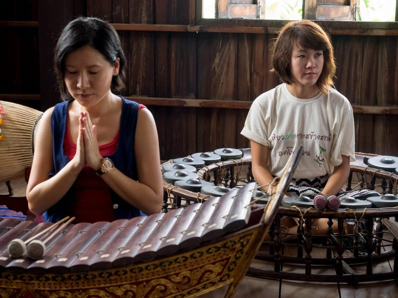 Trying out traditional music instruments at the Chiang Khan music school