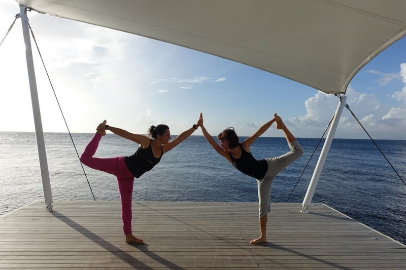 Doing a dancer pose at AWAY SPA Maldives | Yogi in Action