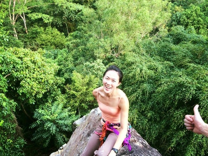 View of the forest below at one of the top anchors at Dairyfarm Singapore. The life of a female rock climber | Rock climbing near me