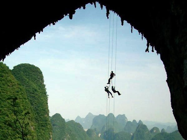 Abseiling down from Moonhill in Yangshuo - image credited to topguilintravel l Rock climbing in Asia