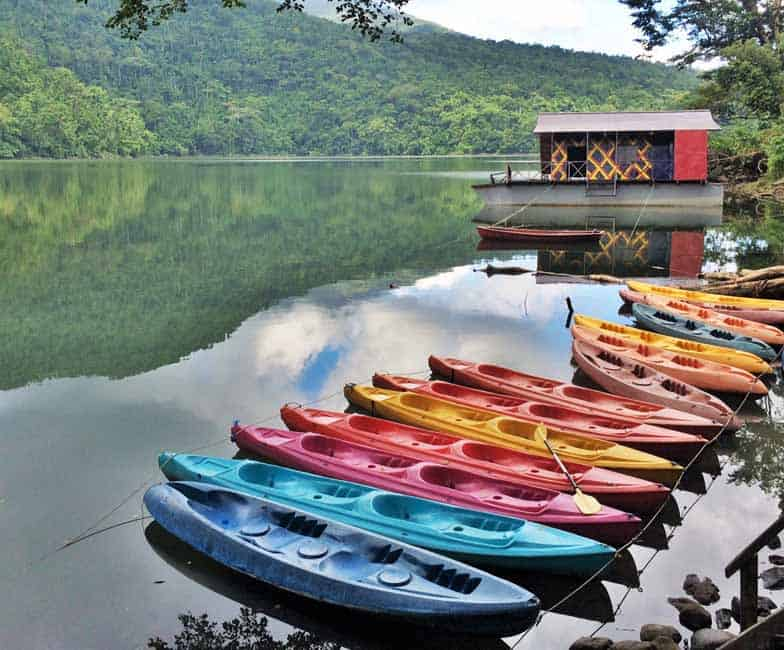 Rainbow colour kayaks calling out to us to start our adventure. outdoor adventure in bicol region
