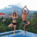 Doing yoga moves at The Oriental Legazpi, can you see the volcano at the back?