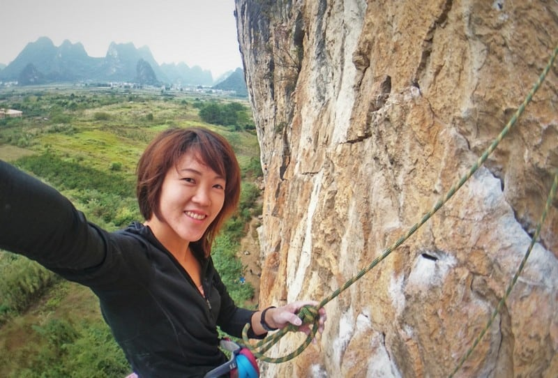 Selfie at the top of the rock climbing route at Yangshuo China | Rock Climbing Asia and China