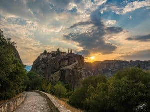 Monastery of the Holy Trinity. The trail to the left leads to the Monastery, but also splits to the right to lead down to Kastraki.- Destinations in the World with the Best Sunrises and Sunsets