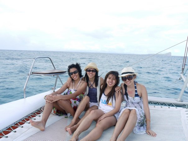 Chilling out on the catamaran as we head towards a private deserted island