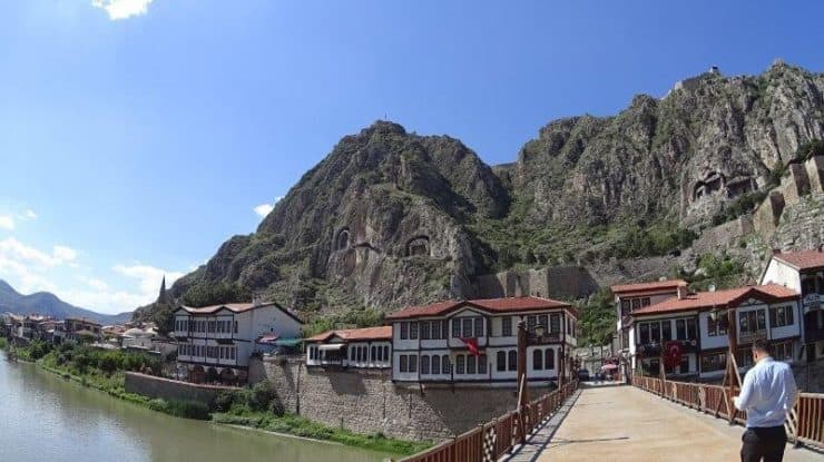 The view of Amasya old ottoman houses, mountain rock tombs and the bridge and river