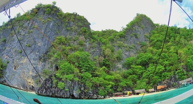 Breezing past stretches of cliffs of limestone rocks - underwater wrecks in coron and diving and snorkeling in palawan