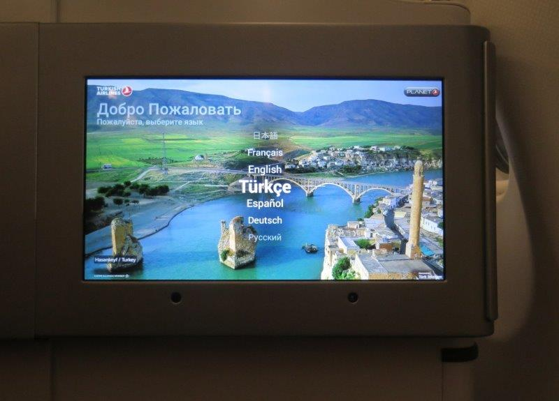 Welcome greetings on board the turkish airlines flight. Large screen to welcome us! Excited to start our black sea region adventure.