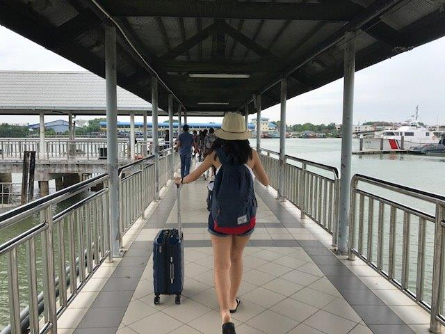 Trotting our way from the Tanjung Gemok Jetty to our hotel with our bags. Magadelene ahead with her pretty little straw hat