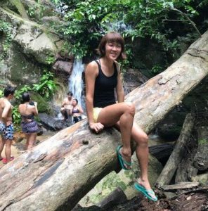 Posing by the fallen trunk near the Asah waterfall. Feeling too cold to play in the icy water, so just chilling around looking pretty instead