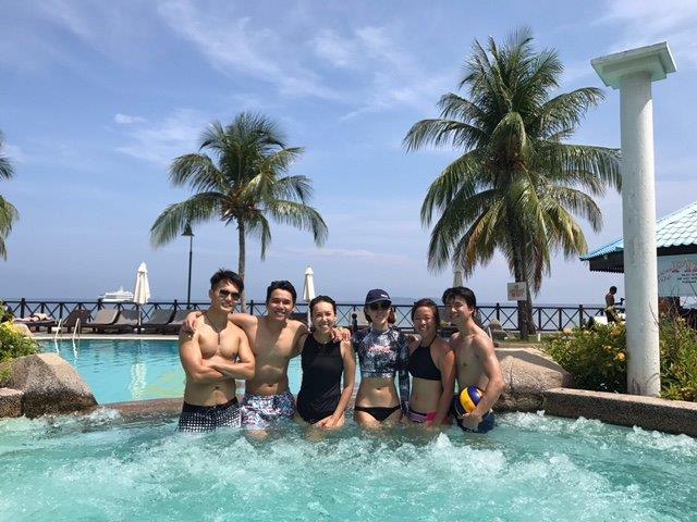 Group shot at Berjaya Tioman Malaysia Retreat Resort jacuzzi pool by the beach.