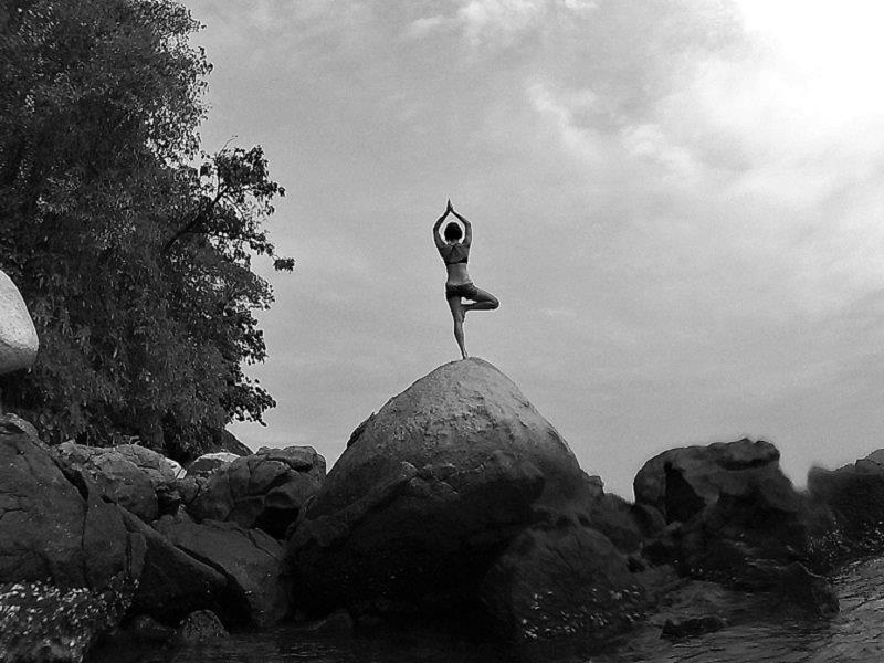 Yoga on the rock in tioman