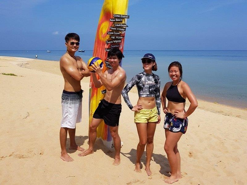 Tioman volleyball hunks and babes with our burnt bodies and feet