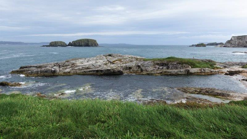 The Iron Islands where The Greyjoys originated from - This piece of rock was where they film some of the night scenes, with fire and smoke | Ballintoy Harbour