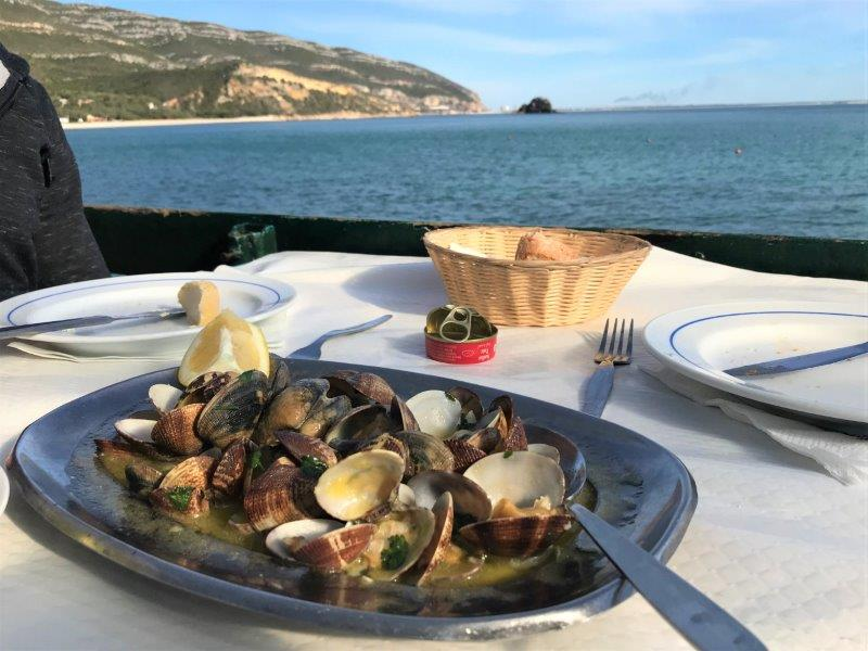 Amazing clams at a restaurant by the shore near Serra da Arrabida National Park. Best Lisbon Seafood!