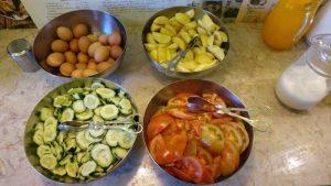 Big bowls of freshly cut veggies and fruit