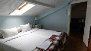 Beautiful loft room at the top floor. I love the window above where you can see the stars when you sleep