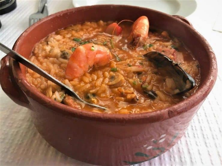 Best seafood restaurant in Lisbon? Popualr dish on the menu - Shellfish Rice. Tasty, rich and flavourful. | Seafood in Lisbon