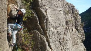 challenging 5C route with a big move - Siurana outdoor rock climbing courses