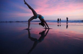 backward bend at kuta beach, Bali