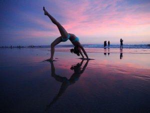 backward bend at kuta beach, Bali | Top 5 Yoga Retreat and Vacation Destinations in Asia to Visit