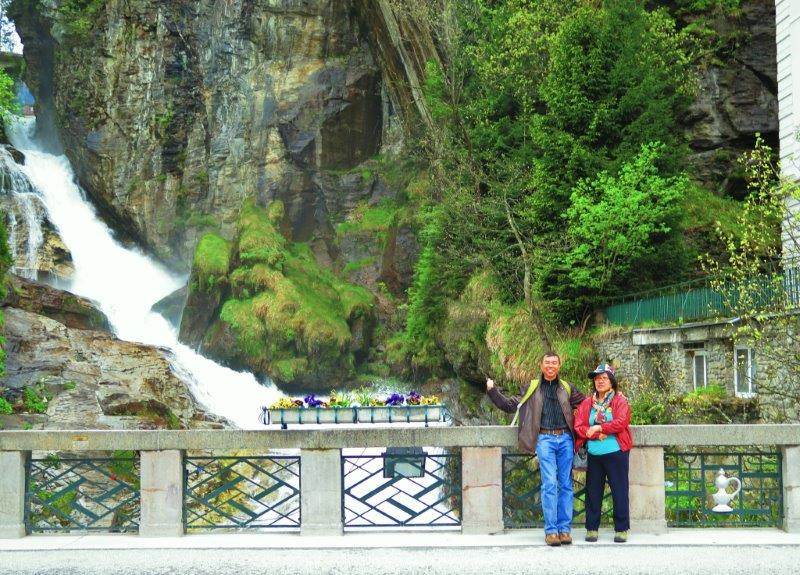 Parents in their 'trendy fashion attire at waterfall in Austria or Germany | The culprits who Love to Travel