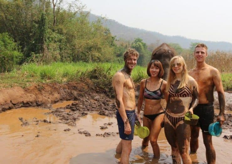 The muddy four. Remco really looks like the elephants has just spat a chunk of mud at him, while in fact it is actually Cezs doing. | Swim with Elephants in Thailand