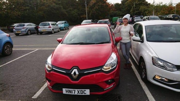 Me and the red manual car we rented to drive us up to Wales Mount Snowdonia. It was cold as we were heading up as you can see with me and my wolly hat.