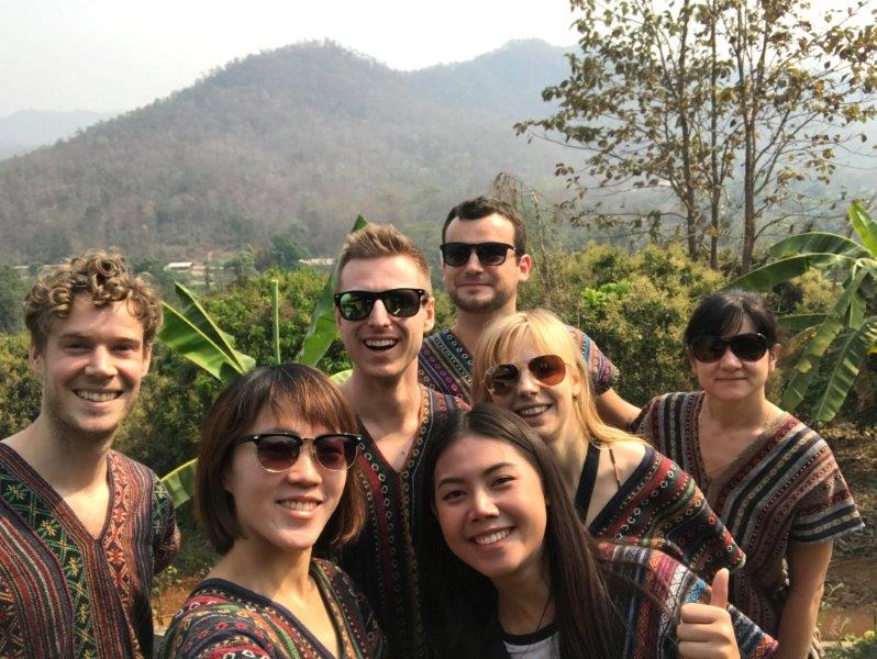 Group shot in our traditional thai design tops! Ready for our Chiang Mai Elephant Tour..