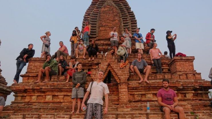 The entire entourage of campers perched on a pagoda enjoying the sunrise | Where to go in Myanmar