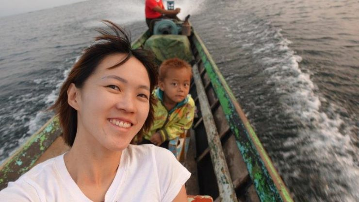 Drifting down the Inle Lake with the boat man and his son