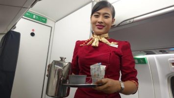 Myanmar Airlines Cabin Crew in their beautiful maroon outfit