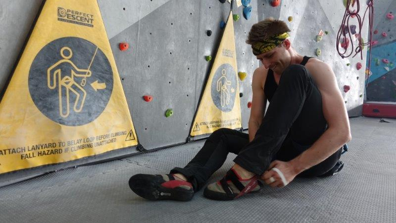 Cez putting on his fitting and snug climbing shoes and is ready to do some serious climbing | Lead Climbing in Bangkok