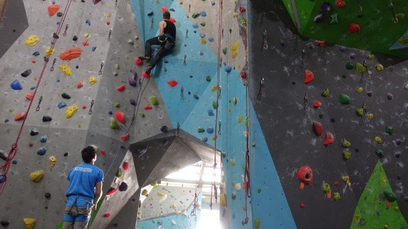 Cez on his 1st lead belay route in rock domain | Lead Climbing Courses in Bangkok