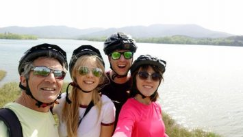 Group shot with Atilio and all our helmets on | Summer Activities at Banyoles Lake